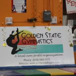Image of Golden State Gymnastics banner with logo, phone number and website