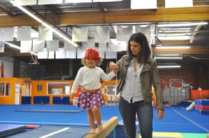 Mom with toddler daughter on balance beam